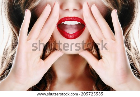 Attractive young sexy woman is announcing,  telling a secret, shouting or yelling - stock photo