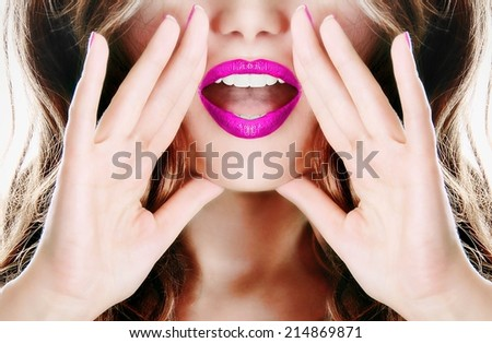 Attractive young sexy woman with pink lipstick lipgloss lips is announcing, telling a secret, shouting or yelling  - stock photo
