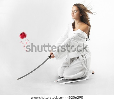 Attractive young sexy women with samurai sword on white background - stock photo