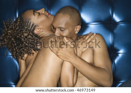 Attractive young shirtless couple in an intimate embrace. Horizontal shot. - stock photo