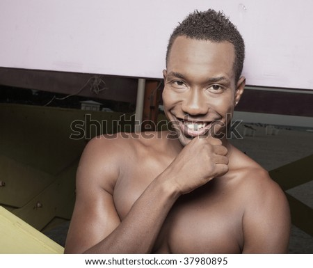 Attractive young shirtless male smiling