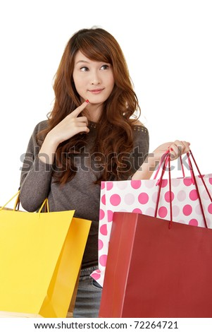 Attractive young shopping woman thinking, closeup portrait on white background. - stock photo