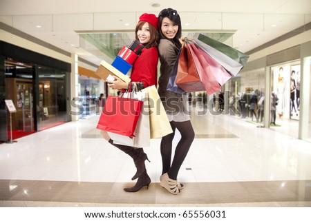 attractive young sister go shopping in the mall - stock photo
