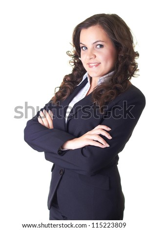Attractive young smiling girl in a black business suit. Girl standing with folded hands. Isolated on white background
