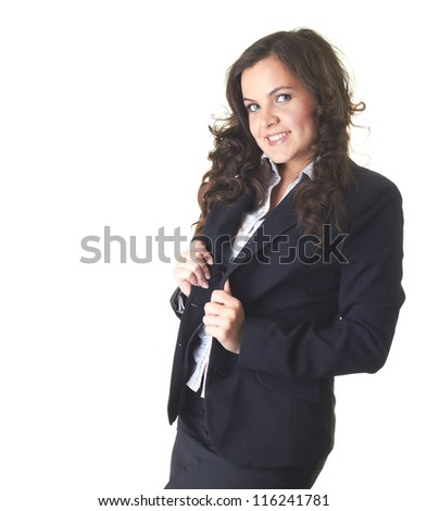 Attractive young smiling girl in a black business suit. Isolated on white background
