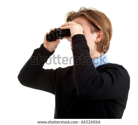 attractive young  spy man looking through binoculars