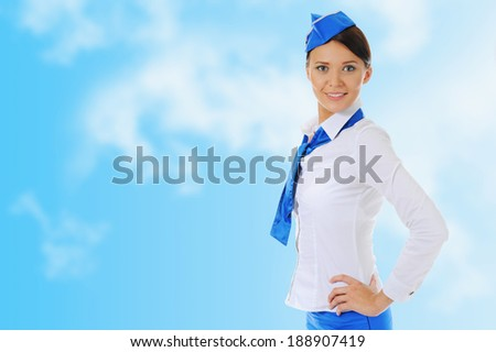 Attractive young stewardess isolated sky blue background - stock photo