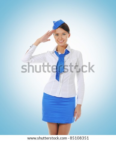 Attractive young stewardess on a blue background