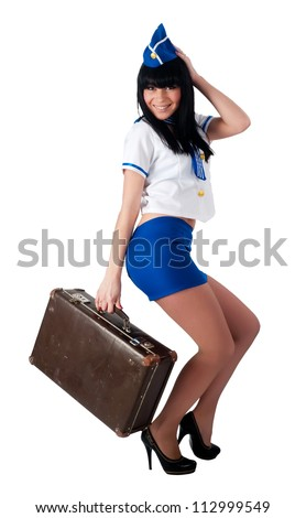 Attractive young stewardess with old-fashioned suitcase. Isolated on white - stock photo