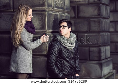 Attractive young stylish couple in love dressed in warm cloths outdoors  - stock photo