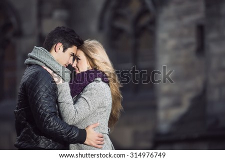 Attractive young stylish couple in love embracing outdoors