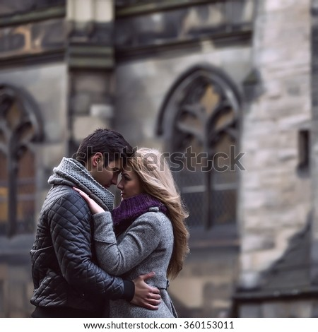 Attractive young stylish couple in love embracing outdoors  - stock photo