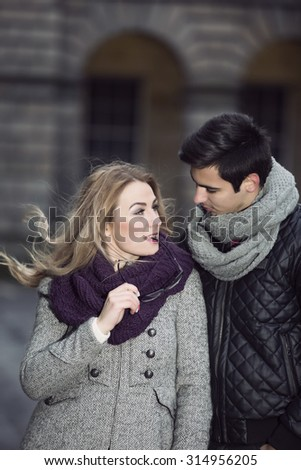 Attractive young stylish couple in love outdoors