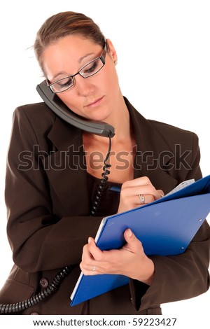Attractive young successful female businesswoman making a phone call.  studio shot.