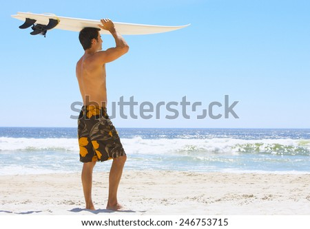 Attractive young surf man - stock photo
