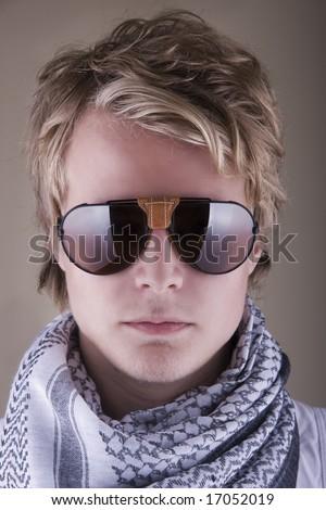 Attractive Young Swedish Man Wearing Aviators - stock photo