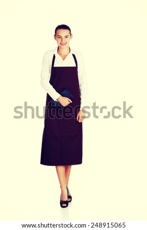 Attractive young waitress with notebook in hand. - stock photo