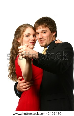 Attractive Young well-dressed couple dancing - stock photo