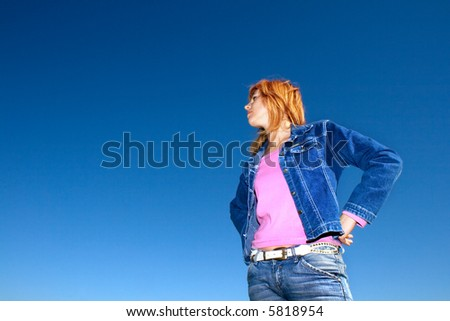 attractive young woman against sky - stock photo
