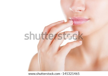 Attractive young woman applying lip balm isolated on a white background - stock photo