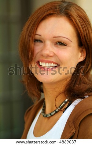 attractive young woman, being all smiles - stock photo