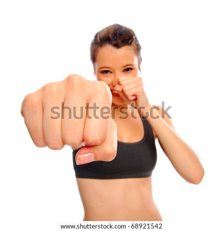 Attractive young woman boxing as a form of exercise, selective focus on fist, isolated on white - stock photo