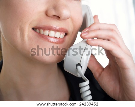 attractive young woman calling by  phone.