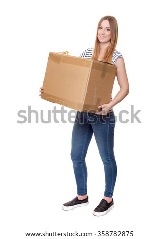 Attractive young woman carrying moving box - stock photo