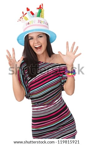 Attractive young woman celebrating birthday, smiling, looking at camera. - stock photo