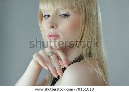 Attractive young woman close up studio portrait - stock photo