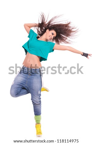 attractive young woman dancer posing on white background. she is standing on one foot and extending a hand to her side - stock photo