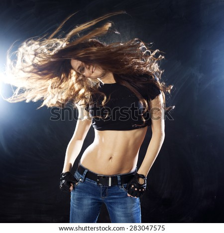 attractive young woman dancing, hair flying - stock photo