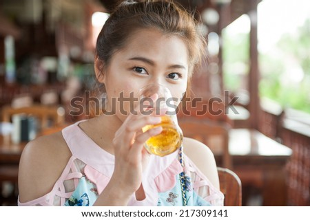 Attractive young woman drinking a beer
