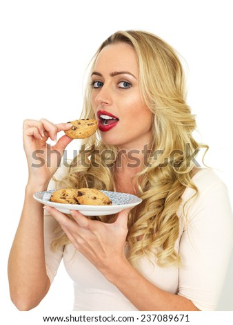 Attractive Young Woman Eating Biscuits