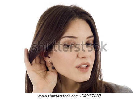 Attractive young woman eavesdropping isolated over white background