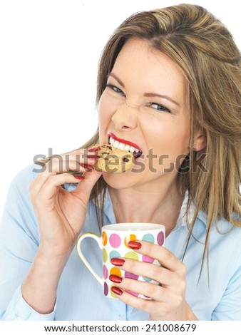 Attractive Young Woman Enjoying Tea and Biscuits - stock photo