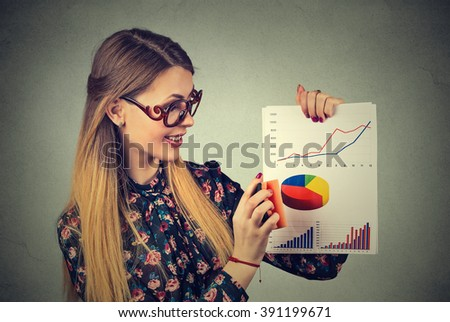 Attractive young woman entrepreneur wiping out excellent good financial wall street market results  - stock photo