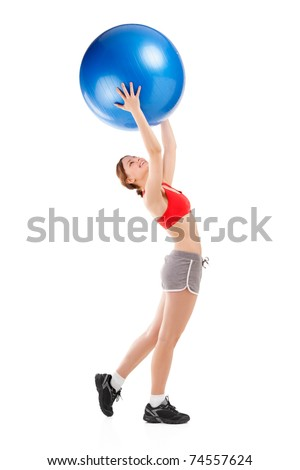 Attractive young woman exercising on an exercise ball