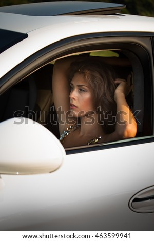 attractive young woman fashion portrait in car summer day