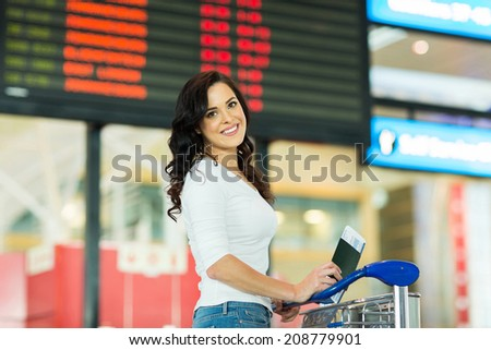 attractive young woman going on a trip by air - stock photo