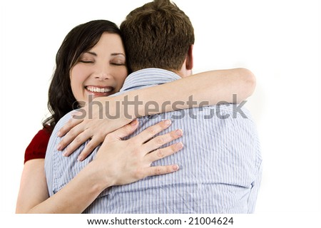 Attractive young woman happily embracing her friend - stock photo
