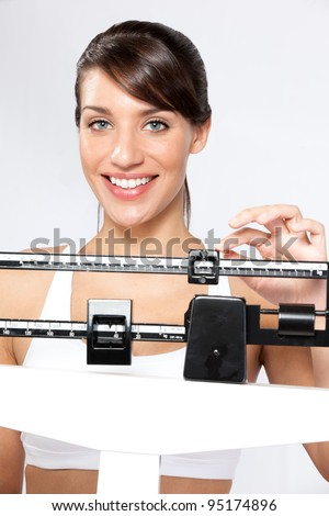 attractive young woman happy with weight - stock photo