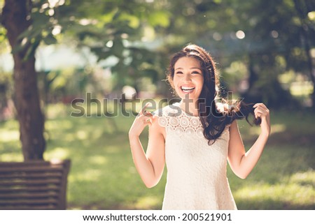 Attractive young woman having fun in the park - stock photo