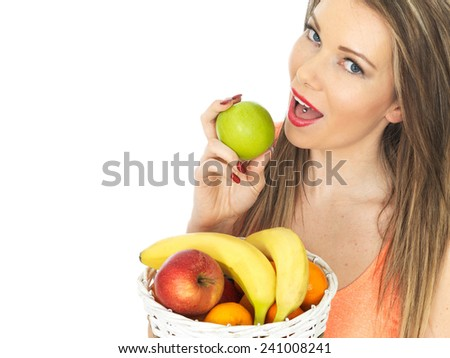 Attractive Young Woman Holding a Basket of Fresh Fruit - stock photo