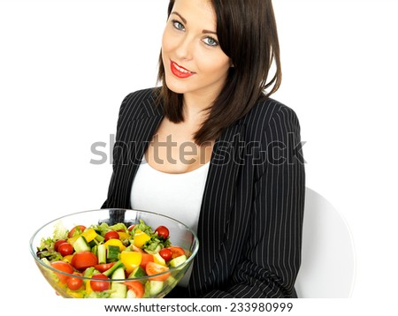Attractive Young Woman Holding a Bowl of Mixed Salad - stock photo