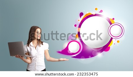 attractive young woman holding a laptop and presenting abstract speech bubble copy space - stock photo