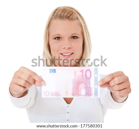 Attractive young woman holding 10 euro - stock photo