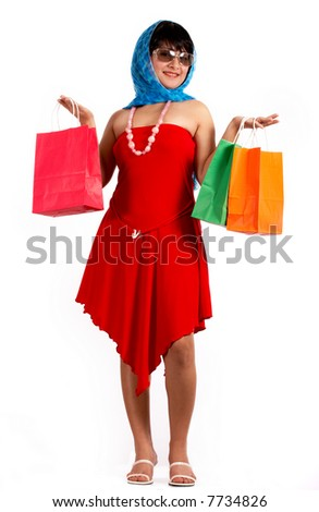 Attractive young woman holding some shopping bags
