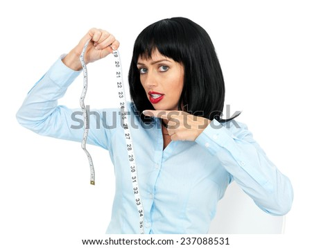 Attractive Young Woman Holding Tape Measure - stock photo