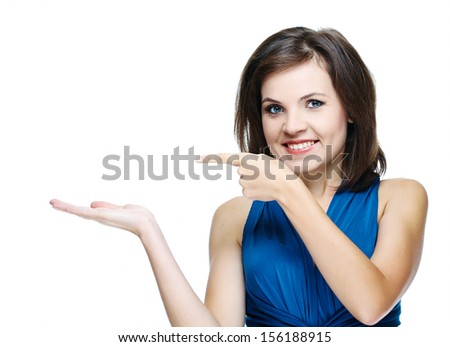 Attractive young woman in a blue dress. Holds in her right hand an imaginary object and points a finger at him. Isolated on white background - stock photo
